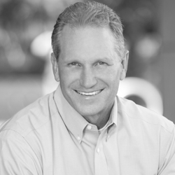 """Kennan Burch is the founder of Brand Catalyst Partners. He is a sought after speaker, brand catalyst and coach. His vision is """"inspiring brands to live their highest promise."""""""