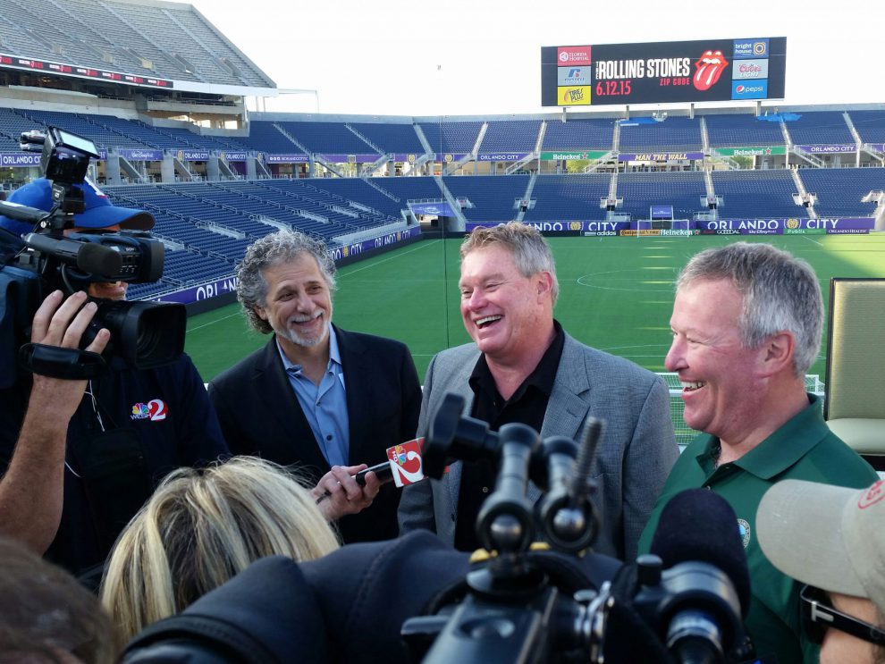 Allen Johnson (center) and Orlando Mayor Buddy Dyer (right) at 2015 Rolling Stones concert announcement at Camping World Stadium