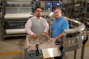 Picture of founders of Custom Metal Designs in the manufacturing warehouse.