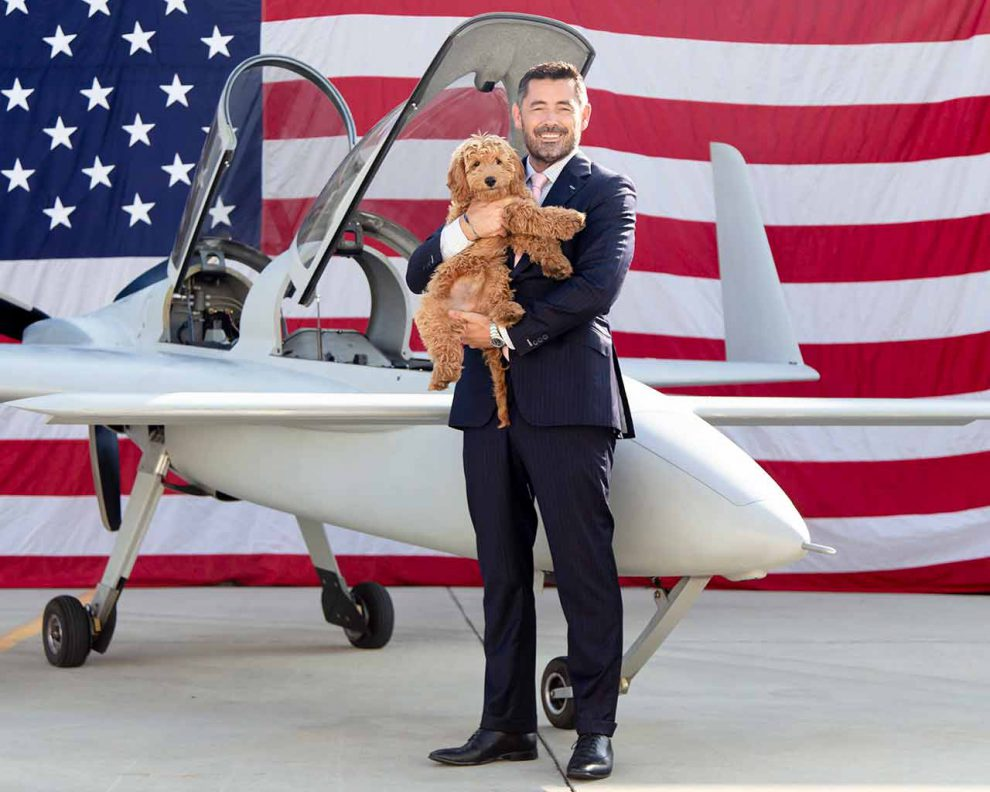 Daniel Robinson and his dog, Petey, whose title is chief morale officer, with the Berkut 540 airplane