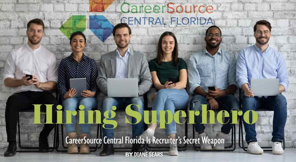 Picture of smiling people waiting in lobby for an interview with CareerSource Central Florida logo on the wall behind the interviewees