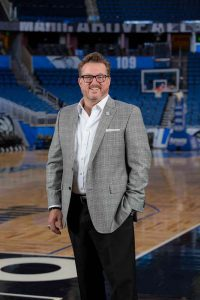 Picture of Jason Siegel, president and CEO of the Greater Orlando Sports Commission standing in the amway arena